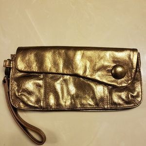 Gold metallic leather Fossil clutch